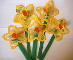 Daffodil Suncatchers - Although the weather is beginning to change, the flowers are yet to come. Make this delightful bouquet w/kids using colored paper, sticky clear paper, and your imagination.