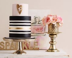 A pink and gold cake table featuring black and white stripes, gold glittering hearts and sparkling details. Perfect for a birthday, bridal shower or Valentine's Day. Created by De la Creme Creative Studio.