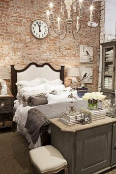 pillows, bedding, exposed brick, chandelier