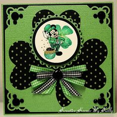 handmade St. Patrick's Day card ... black and green ... like the way these colors work together on this card ... huge heart shamrock with bows and a layered medallion with Micky Mouse image .. ...