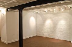 White walls, white ceiling basement.