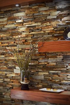 This interior stone wall is a stunning example of an interior stone veneer idea in combination with a gorgeous stone fireplace using Buechel Stone's Cinnamon Bark Ledgestone veneer to add the perfect amount of charm to this room. - June 02 2019 at Casa Rock, Stacked Stone Walls, Stacked Stone Backsplash, Faux Stone Walls, Stacked Stone Fireplaces, Wood Stone, Farmhouse Fireplace Mantels, Fireplace Surrounds, Stone Veneer Fireplace