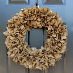 cut burlap in strips, tie on wreath form! fantastic! so many variations you could do