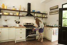 Modern farmhouse Ikea kitchen - Adel white cabinets, butcher block countertops, Martha Stewart brass pulls, double Domsjo farmhouse sink
