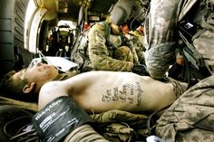 No Idle Boast: A Soldier's Tattoo Becomes Truth. 1st Infantry Division, Hockenberry's world changed June 15. He was on a foot patrol just outside Haji Ramuddin, Afghanistan, when an improvised explosive device detonated nearby. In this photograph, flight medic Corporal Amanda Mosher is tending to Hockenberry's wounds aboard a medevac helicopter minutes after the explosion. Kyle Hockenberry, 19, lost both legs and his left arm in the blast.