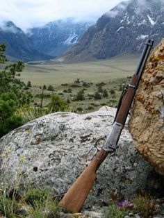 Great picture of the greatest rifle ever made (my opinion of course) A Winchester Model 94 30 30. My Grandpa had one which he gave to my dad. I now have it. It's one of my treasured gifts. I always though it was cool that my Dad had a rifle just like John Waynes.