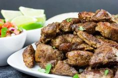 Crispy Pork Carnitas - Slow oven roasted marinated pork cubes with a crispy caramelized crust. Rich, moist, flavorful and so tender it melts in your mouth! Thick Bone In Pork Chop Recipe, Butter Ball Cookies Recipe, Pork Carnitas Recipe, Cube Recipe, Pork Egg Rolls, Mushroom Dish, Pork Chop Recipes, Pork Cubes Recipes, Crispy Pork