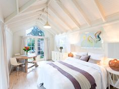 Striking white cathaderal ceiling. #Coastal Exposed roof trusses