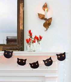 These cat stencils? Yes, Happening. Right meow. ••12  DIY Garlands to Hang Up for Halloween | Brit + Co