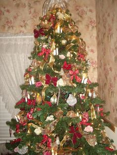 Cheryl's tree.    This is one of my  Christmas trees I decorated. I would love to see other pinner's  trees from your Christmas past.