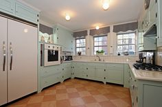 """Country Kitchen with U-shaped, complex granite tile floors, Undermount sink, 4"""" SQUARE TILE - SIMPLY WHITE, European Cabinets"""