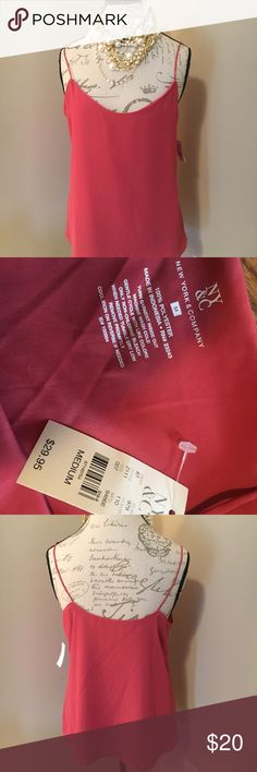 Beautiful tank for work or dress up some jeans! This is more of a salmon color.  It's a double layered tank. Almost silly material New York & Company Tops Tank Tops