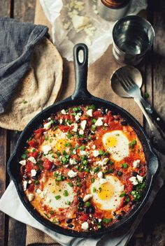 Shakshouka - Shakshouka is a staple of Egyptian, Tunisian, Libyan, Algerian, and Moroccan cuisines traditionally served up in a cast iron pan with bread to mop up the sauce. It is also popular in Israel, where it was introduced by Tunisian Jews