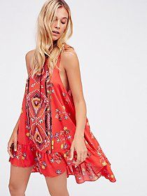 Provence Slip   Beautifully beaded slip pieced with sheer mesh detailing and a racerback. Flowy, crinkly skirt.