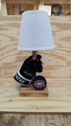 Customizable Hockey Lamp with glove, stick and puck. Any NHL team puck can be used. Any personal puck can also be used if provided by buyer. Base is approximately 6 x6 and height is a range from approximately 15 a 17. The gloves that are used are kid size gloves. They range in size from 9-12. If you would like a larger adult sized glove they are available at an extra cost.