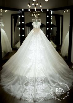 A pretty wedding gown with lace on its train.
