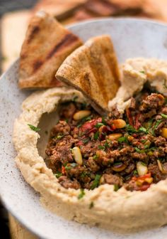 This buttery hummus recipe is served with spiced lamb, and makes the perfect appetizer or main course, on it's own or as part of a Mediterranean feast! Lebanese Recipes, Greek Recipes, Turkish Recipes, Persian Recipes, Middle Eastern Recipes, Mets, Carne, Gastronomia, Kitchen