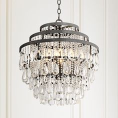 Clear crystal prisms and drops shine in the light of this timeless bronze finish chandelier. 25 high x wide. Canopy is wide. Includes 6 feet of chain, 12 feet of cord. Style # at Lamps Plus. Entryway Chandelier, Chandelier Lighting Fixtures, Crystal Pendant Lighting, Kitchen Chandelier, Bronze Chandelier, Chandelier Lamp, Home Lighting, Light Fixtures, Lighting Ideas