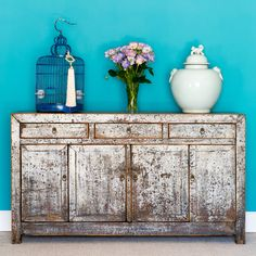Distressed Chinese grey coloured sideboard. c.1930 with a matt finish, originating from the Dongbei Province; lying in the North eastern region of China, bordering inner Mongolia  Handmade with removable shelves and doors, this Asian solid wood cupboard houses four drawers above and four cupboards below, all with decorative brass hardware. http://www.orchidfurniture.co.uk/neutral-lacquered-dongbei-sisdeboard-c-1900