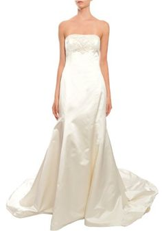 Ivory, Angelic ivory silk wedding gown has strapless square neckline with stunning beading detail along front of bodice. Fit and flare silhouette with chapel length train. Back zipper and button closure.