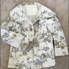 Anthropologie spring jacket Lightweight spring jacket that was never worn. Can wear sleeves long or button up to 3/4. Button all the way up to a funnel neck. Drawstring to tighten around waist. Like new condition. Anthropologie Jackets & Coats