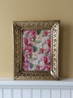 Beautiful gold metal filigree, 5 x 7 picture frame with easle back. Floral design with decorative corner details. Can be stood horizontal or vertical with hook for hanging. In very good vintage condition with original glass & back. Great for special occasion, wedding, baby shower or statement wall decor. Measures 9.25 x 7.25 total, fits a 5 x 7 picture Thanks for shopping YellowHouseDecor!  🌴 Several frames sold separately in shop, convo if you wish to purchase more than one item for…