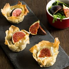These adorable little tartlets from BakingMad.com are ideal for a quick lunchtime bite, picnic or to serve at a special dinner party! This crisp filo pastry cases go beautifully with the classic combination of caramelised onions and goats cheese. Topped with a slice of fig and drizzle of honey - perfection!