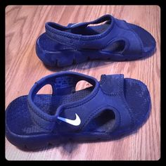 Nike child's water shoes Used and loved! Minimal signs of wear. Child size 11. Nike Shoes Slippers