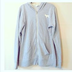 Victoria's Secret Zip-up Worn a few times, normal wear and piling from washing. No stains or rips. Light blue in color with white and black on logo. Hooded, but missing drawstrings, still can wear the good though. Logo on back is made to look worn and imperfect. Slightly longer than a typical VS.  zip-up. Size medium on tag, will work for the oversized look, otherwise better suited for a large. PINK Victoria's Secret Tops Sweatshirts & Hoodies