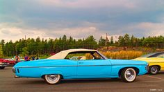 Evening at the drive-in Starring: 69 Chevrolet Impala (by kenmojr)