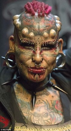 """Mexican body modification and tattoo artist """"Vampire Woman?Ä, poses during the last day of the Quito Tattoo Convention in Quito, Ecuador"""