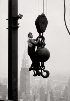 U.S. Empire State Building worker riding 'the ball', NYC, 1930-31