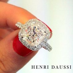 Seal the deal with a classic Henri Daussi cushion cut halo diamond engagement ring!