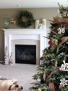 Cozy Christmas room with wreath and candles on mantel