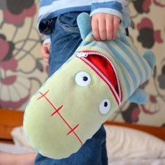 Billed as a 'booboo' doll to eat your child's worries away. I really like the idea of the zipper mouth to store...whatever!