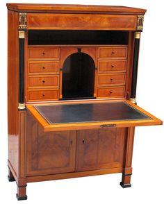 German Biedermeier secretaire in cherrywood on oak. Fall-front, frieze drawer and bookmatch veneered doors panelled with hairlines. Greek Key motif. Ebonized columns with gold leaf trim. Magnificently detailed marquetry panel depicting houses, people and a lake with boats and swans. Fitted interior with eight drawers and niches. Before 1825. Southwest Germany (French border).