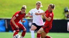 Ada Hegerberg of Norway is challenged by Simone Laudehr of Germany