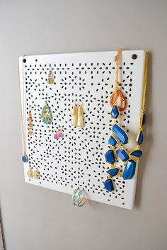Screw a Variera shelf insert to a wall and use it to organize your jewelry.   33 Unexpected Things You Can Make With Ikea Products