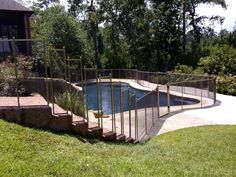 Custom Pool Safety Fence cut to the dimensions of the stairs.