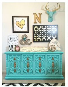 Retro turquoise dresser make over used in a nursery as a change table
