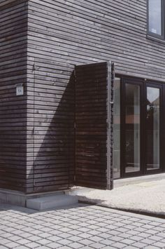 House With Shutters Rural House Featuring a Barn Like Facade by Beker Architekten