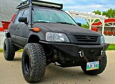 Matte Black Lifted CR-V with top rack.