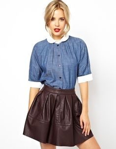 Love this 50's style blouse. The brown leather mini skirt not so much.