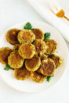 Inspired by our trip to Israel, I created a baked falafel recipe that is just as easy as it is tasty! It's made with canned chickpeas so there's no soaking necessary. Top bowls or salads with these protein-packed patties. #falafel #easy #vegan #chickpeas #glutenfree