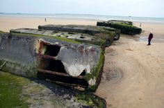 "Arromanches ~ Gold Beach ~ Normandy ~ France ~ Remains of the Allied ""floating pier"" from World War II."