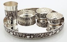 A traditional silver thali set...