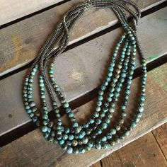 "Turquoise and silver bead necklace Round 8mm & 10mm African Turquoise 6mm hematite silver beads Clasp closure 32"" long Great stand alone or layering piece H"