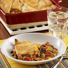 A taco pot pie with black beans, corn, zesty tomatoes and taco seasoning topped with crescent dough