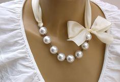 Carrie Bradshaw  Inspired Pearl Necklace In Cream Ribbon - The Choker Version. Perfect for Bride, Wedding, Bridesmaids And Formal. $39.00, via Etsy.