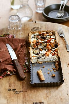 Spring tart with a thick layer of creamy, tangy ricotta and sour cream with roasted eggplant, sweet potato, and Spanish onion...Mmmm